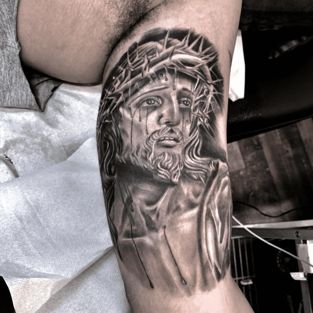 immagine di Cristo: tattoo religiosi